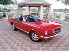 Mustang- this was, is and will remain my dream car...candy apple red with rag top... 64 1/2 or 65