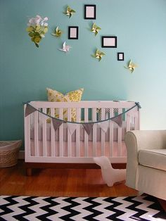 The color combo is great.  But I really love the bunting used to dress up a bumperless crib.
