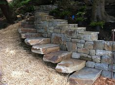 Stone landscaping---use stones and pavers to build custom steps and dividing wall Dry Stack Stone, Dry Stone, Brick And Stone, Stone Work, Stone Walls, Stone Landscaping, Backyard Landscaping, Rock Retaining Wall, Garden Stairs