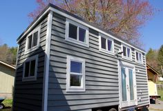 The Chickadee tiny home is an 8×24 design featuring two lofts, stair storage, and a bathtub Turnkey: $55,300
