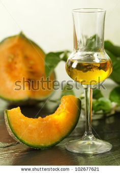 stock photo : melon grappa with fruit over ardesia table