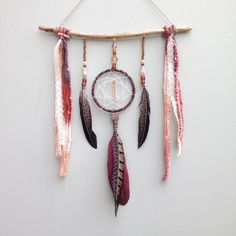 Great mix of found objects and craft items. Lots of great textures. Dreamcatcher Wall Hanging Boho Feather Wall by InspiredSoulShop