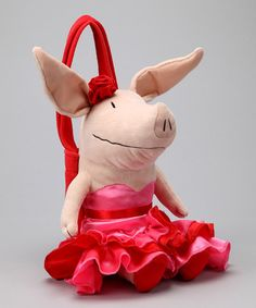 This darling double of the sweetest swine in town comes equipped with a plush strap so little OLIVIA lovers can take this precious pig companion everywhere they go. Complete with a small zippered pouch, the OLIVIA comes freshly dressed in a ruffly flamenco dress and rose headpiece.6'' W x 14'' H x 3'' DSatin nylon / plush