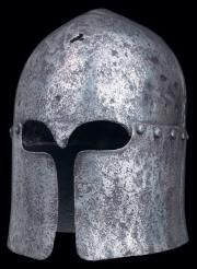 A rare Venetian sallet, celata alla VeneZiana, of the type included in the hoard of armour discovered in the Venetian frontier fortress of Chalcis, circa 1450 with hemispherical skull formed in one piece, rising to a low medial ridge over the crown, cut out over the eyes to form a Y-shaped face-opening, the base encircled by a band of rivet holes, fitted with a characteristically overlapping lower section.
