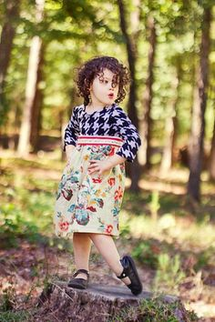 Hounds tooth dress, black and grey, with large scale floral print and red stripe belt, sizes 12m - 8