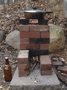 "We built this rocket stove out of some scrap bricks -- based off of a model called the ""16 brick"" rocket stove.  Once it's up to heat it really burns like a rocket as the air rushes through and the gases combust at very high temperature. Carbon sequestering meal preparation... We're working on a more permanent design that incorporates a rainwater fed sink, chopping/meal prep station and a nice fuel wood storage area to boot."