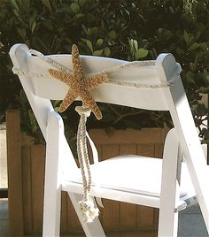 Love this natural wedding decor!   Beach Weddings - Natural Starfish Chair Decoration. $14.00, via Etsy. Very sweet idea for a beach wedding!