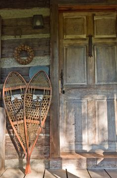 Vintage Snowshoes create an iconic Wintertime Rustic Lodge Decor. Perfect for the holidays.