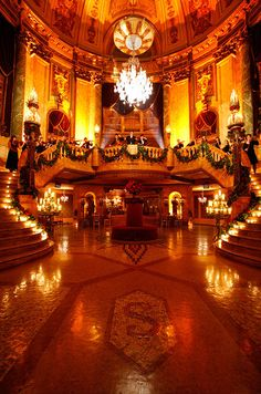 Image entering this grand foyer filled with candles and an orchestra to boot!