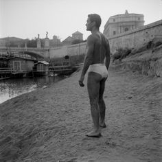 """Pier Paolo Pasolini on the asphalt of the Tiber. Ph: Toti Scialoja, circa """"The cinema is an explosion of my love for reality. Bw Photography, Vintage Photography, The Decameron, I 3 U, Italy History, Pier Paolo Pasolini, Yul Brynner, Art Of Man, Sex And Love"""