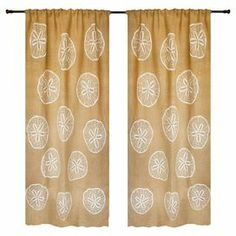 """Showcasing a charming sand dollar motif, this burlap curtain brings coastal inspiration to your windows. Handmade in the USA.   Product: CurtainConstruction Material: BurlapColor: White and beigeFeatures:  3"""" Rod pocketHandmade by TheWatsonShopMade in the USA Dimensions: 84"""" H x 50"""" W Note: Image depicts two panels, but price is for one"""