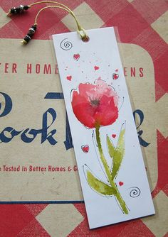 TITLE: Spring Flower Watercolor Bookmark  A 6 x 2 happy little watercolor bookmark to save your place in a favorite cookbook, mystery or romance novel.  Printed on archival fine art paper and protected with a clear cellophane sleeve. Bookmark comes with a pretty beaded cord. Each bookmark may have slight variations.