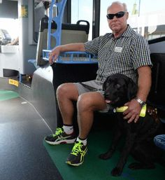 OUT AND ABOUT: Graeme Raines and his guide dog Levi on a Duffy's City Bus.