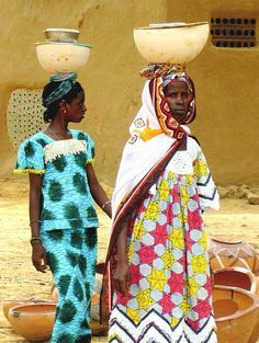 african women carrying colourful baskets