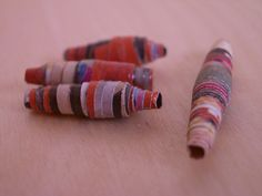 You can make these cool paper beads out of junk mail! These look amazing on necklaces, bracelets, and even in shadow boxes! They are very easy to make, and you can put those annoying cards and letters from businesses to use!