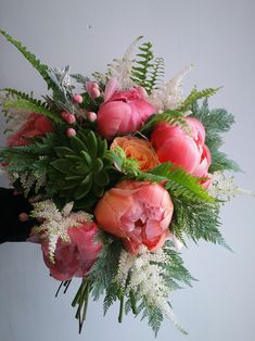 Bridal bouquet for a tropical themed wedding. Coral sunset peonies, miss piggy roses, echiverias and ferns  www.freshflower.co.uk