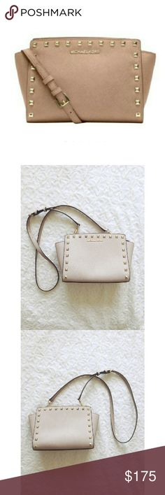 {michael kors} selma stud medium messenger Sized right for all your daily essentials, this scratch resistant saffiano leather Michael by Michael Kors medium messenger bag is perfect for your everyday needs  Stylish, chic & elegant  Finished with chic pyramid studs  A nice neutral color that matches everything with gold tone accents  Top zip closure with one interior zip pocket Detachable adjustable crossbody strap   Comes with dust bag Excellent used condition- almost looks new! Retails $248…