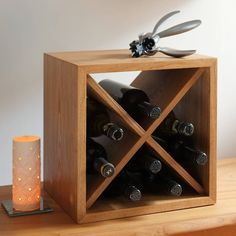 A simple, elegant oak wine cube which holds up to 12 bottles and is perfect for keeping the 'drinking' wine in the house!This wine rack is a lovely compact size and it's versatility means it can be a stand alone table feature, a stackable display unit or wall mounted storage. Why not personalise it with a name and date as a wedding gift or with a special message for a birthday or Christmas present? The Wine Cube is made from FSC approved sustainable wood stock and will be delivered…