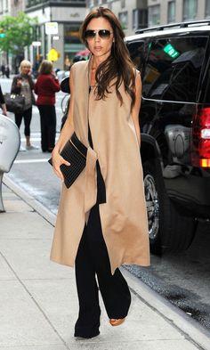 Victoria Beckham #BestDressed in a sleeveless camel coat & wide-leg trousers
