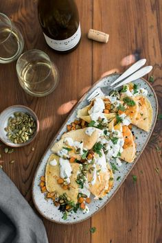 A perfect fall dinner with chipotle butternut squash crepes topped with a homemade cilantro crema and toasted pepitas. Vegan swaps suggested too! Easy Crepe Recipe, Crepe Recipes, Vegan Dinner Recipes, Vegetarian Recipes, Healthy Recipes, Delicious Recipes, Tasty, Crepes, Chipotle