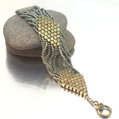 A personal favorite from my Etsy shop https://www.etsy.com/listing/254121621/diamond-brick-stitch-bracelet