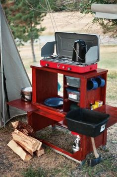 Camp Kitchen Box- this links to a set up you can buy, but I could see making this out of an old Craftsman tool box.