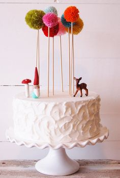 Adorable boquets of yarn pom pom trees that are sure to add some charm and uniqueness to your cake! You can stick them in your cakes at any