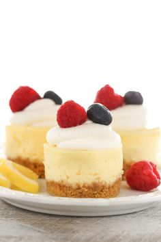 These Mini Lemon Cheesecakes feature an easy homemade graham cracker crust topped with a smooth and creamy lemon cheesecake filling. Top them with some fresh whipped cream and berries for an easy dessert everyone will love!