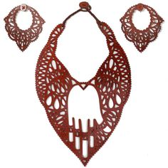 For Sale on - This marvelous three-piece Jean-Paul Gaultier necklace & earrings set features a laser-cut leather bib necklace and matching clip-on earrings. Laser Cut Jewelry, Bold Jewelry, Jewelry Sets, Jewelry Watches, Jewelry Accessories, Jewelry Design, Jean Paul Gaultier, Elements Of Style, Hamsa