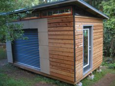 Idea for the side door - garage style roller door for bringing large things out/opening up shed? DIY Modern Shed project Backyard Studio, Backyard Sheds, Outdoor Sheds, Garden Sheds, Garden Tools, Outdoor Gardens, Building A Shed, Building Plans, Building Ideas
