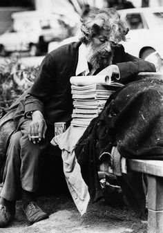 Homeless Man Reading Books