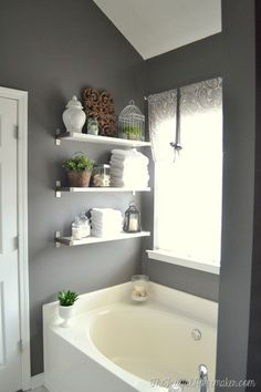 Optimisation petite salle de bain ou astuce fonctionnelle Free up some counter space with IKEA EKBY shelving. Check out these ideas for creating modern, functional bathroom storage space! Bathtub Surround, Shelves, Ikea Ekby, Floating Shelves, Bathroom Shelf Decor, Home Decor, Bathroom Makeovers On A Budget, Bathroom Design, Bathroom Decor