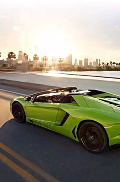 A green lamborghini on the road to the city
