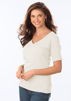 You'll love the fit and feel of our Long Elegant Legs Ultimate Tees. The stretch cotton fabric conforms to your body without ever clinging! . V-Neck Tee has a raglan sleeve, and single breast pocket. Your choice of Lilac, Sunkiss, Mint, Ivory, or Navy. #LELspring