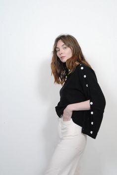 Drapey and versatile, this knit features a boatneck and four workable sleeve buttons.Fabric Pima Cotton Model wearing size S Essential Wardrobe Pieces, Tailored Jacket, S Models, Black Sweaters, Bell Sleeve Top, Turtle Neck, Menswear, Button, Sleeves