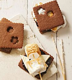 White Chocolate and Jam S'mores....New flavors transform traditional s'mores into a showstopping affair. Rich and creamy white chocolate and sticky blackberry jam add an air of elegance to the campfire sweet.