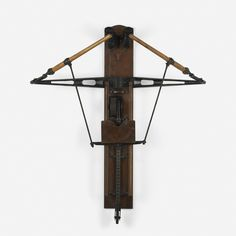 Lot 201: Wright & Diston. rowing machine. 1884, ash, walnut, steel, iron. 61 w x 26 d x 73 h in. estimate: $2,000–3,000.