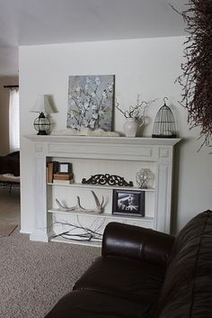 i like this one for a fake fireplace in the living room.  not trying to make it look like something it isn't, and also gives more display space!  Light my Fire: Mantles Galore - Remodelaholic | Remodelaholic