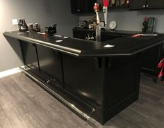 Our customers continue to build beautiful home bars. This one was custom crafted by Tony in PA from solid hardwood and finished with a gorgeous dark ebony stain trimmed with our Chicago bar rail.