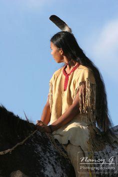 A Native American boy riding bareback on a Indian horse on the prairie of South Dakota. Nancy Greifenhagen Photography