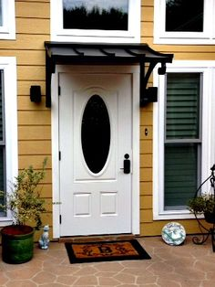 The Black metal Concave Door Awning in Conroe, TX. Metal Door Awning, Front Door Awning, Porch Awning, Window Awnings, Door Overhang, Awning Canopy, Door And Window Design, Door Design, House Design