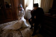 Layusa Ibragimova, 16, recites her wedding vows in the presence of a local imam. In Chechen tradition, couples say their vows separately.  The Girls of Chechnya - photo by Diana Markosian