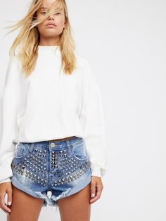 Limited Edition Bandits | **Fit:** Runs large, we recommend sizing down. Distressed denim cutouts featuring allover metal stud detailing. * Distressed detailing and frayed edges * Five-pocket style * Button fly