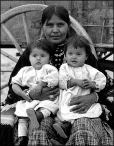 A Navajo woman and her twin children. Photo taken between 1914 and 1930.