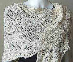 Free pattern...this looks like crochet....I would actually buy this shawl because the pattern is so beautiful.
