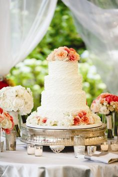 Four-Tier Red Velvet Cake Topped with Fresh Flowers | Something Different Cake Couture | Brian Dorsey Studios | TheKnot.com