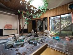 "Zen garden-themed room in abandoned couples motel in Tokyo. Separate stairs lead from the hall to each of the ten rooms and the interior is very similar to the ""love-motels"" where you can book a room for two for just a couple of hours. A similar theme-room motel is still in operation in the Wisconsin Dells called the Don Q Inn."