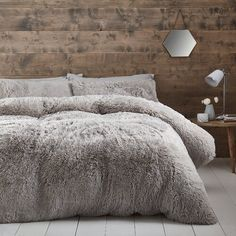 Catherine Lansfield Cuddle up, get cosy and super warm under this duvet cover set, shaggy faux fur bedding with a plush soft touch fleece reverse perfect for a duvet day.