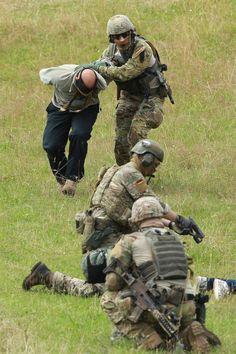Troops of the elite German KSK unit demonstrate their skills at the Bundeswehr base during the visit of German Defense Minister Ursula von der Leyen on July 14, 2014 in Calw, Germany.