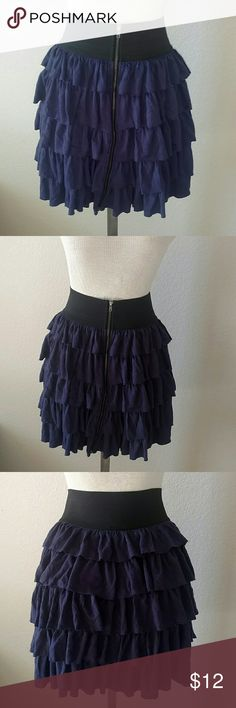 High-waisted Charlotte Russe Skirt Navy ruffled skirt with a thick black elastic waistband and front zipper. Black elastic measures 23.5 inches. Length of zipper and skirt measures 17.5 inches. Charlotte Russe Skirts